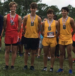 Port Charlotte High's Tyler Wadsworth, left, poses with the top three finishers of the Class 3A-Region 4 race from Miami Belen Jesuit on Saturday at South Fork High School in Stuart. Wadsworth finished fourth and will advance to the state meet.