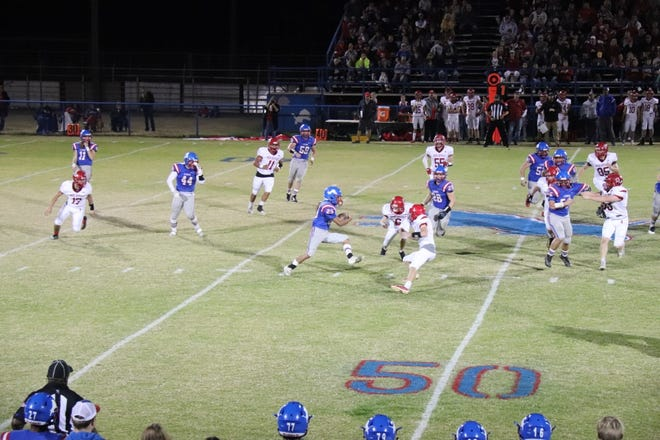 Chandler's Casmen Hill (25) looks for an opening Friday night against the Prague Red Devils.