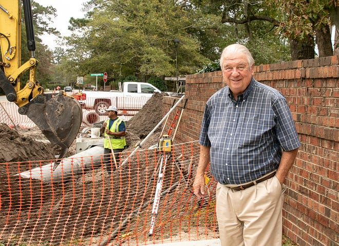 Trent Woods Mayor Chuck Tyson stands at the intersection of Devonshire and Country Club Road, where work is going on to prepare the intersection for new sidewalks. [Bill Hand / Sun Journal Staff]