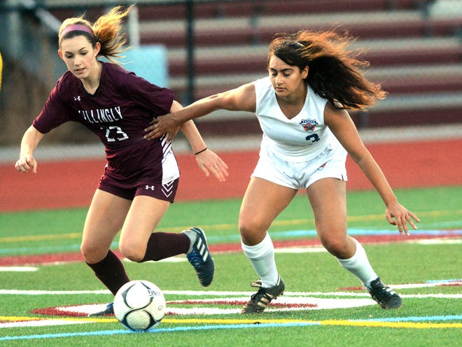 Killingly's Emma Girardin and Windham Tech's Sophia Romeo battle for the ball Thursday during their game in Killingly.