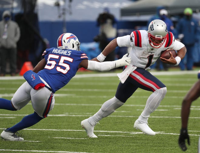 Patriots quarterback Cam Newton is pressured by the Bills' Jerry Hughes last Sunday in Buffalo.