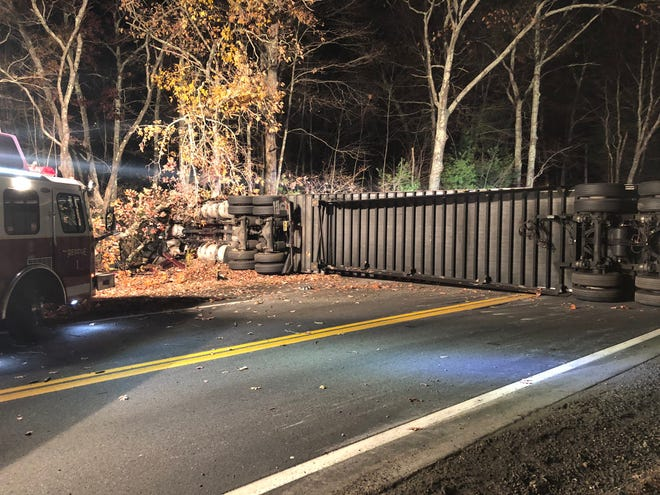 A tractor-trailer lies on its side on Webster Street (Route 16) in Douglas early Saturday morning.