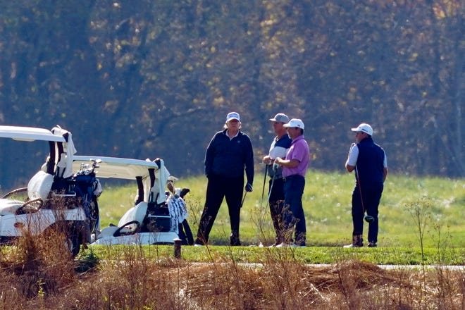 President Donald Trump participates in a round of golf at the Trump National Golf Course on Saturday in Sterling, Va.