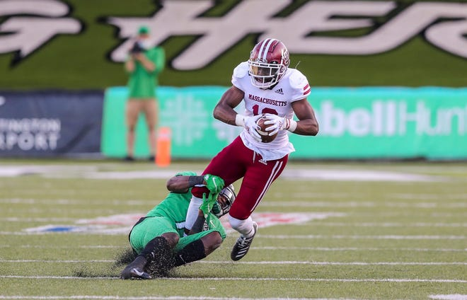 UMass wide receiver Samuel Emilus catches a pass and is tackled by Marshall defensive back Jaylon McClain-Sapp during the third quarter Saturday.