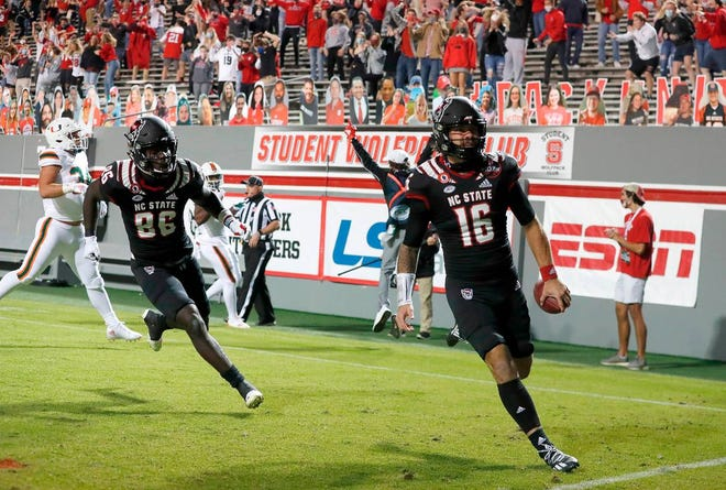 N.C. State quarterback Bailey Hockman (16) celebrates after scoring on a 31-yard touchdown reception during the first half of N.C. State's game against Miami at Carter-Finley Stadium in Raleigh on Friday.