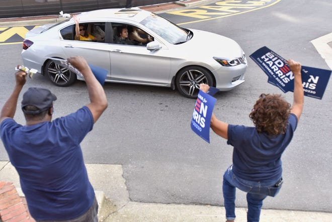 People driving past the Market House honk their horns to show their support for President-elect Joe Biden on Saturday.