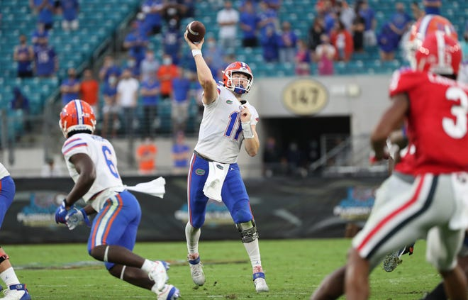 Florida quarterback Kyle Trask has 22 touchdown passes, tied with 2019 Heisman Trophy winner Joe Burrow for the second most in SEC history through five games, and has at least four in every outing this season.