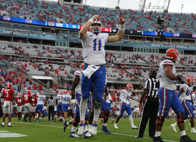 Kyle Trask celebrates a touchdown during the Gators' game Saturday against Georgia in Jacksonville.