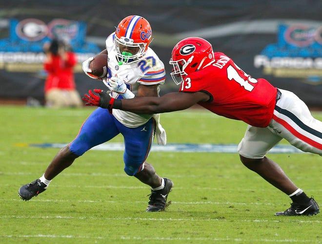Florida running back Dameon Pierce picks up yardage Saturday against Georgia at TIAA Bank Field in Jacksonville.