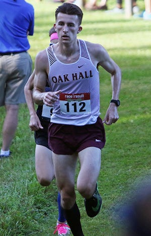 Oak Hall's Austin Montini runs in the lead at the 1-mile mark Friday morning at the Region 2-Class 1A cross country meet at Holloway Park in Lakeland. He went on to finish in 16:18.24 to win the boys race by 10 seconds.