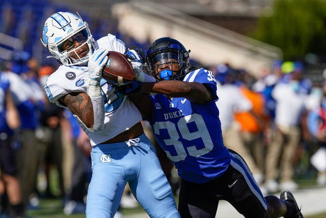 North Carolina receiver Emery Simmons, left, hauls in a 51-yard catch on Duke defensive back Jeremiah Lewis during Saturday's game at Wallace Wade Stadium.