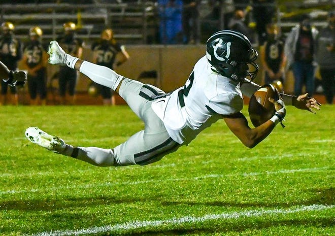 Pueblo South's George Longoria dives over the goal line for a touchdown against Canon City on Nov. 6, 2020, in Citizens Stadium at Canon City High School.