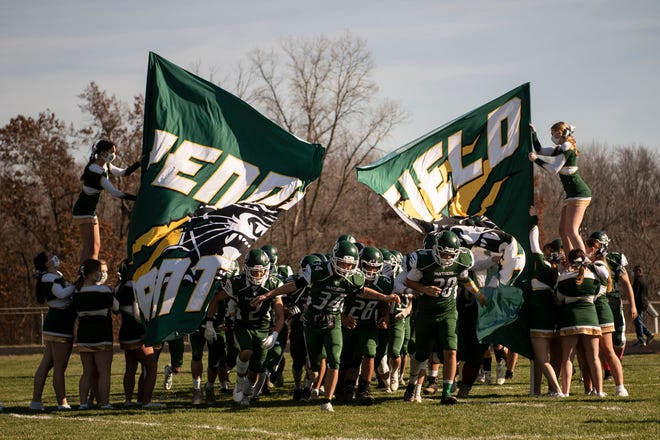 Pennfield varsity football players enter the field on Saturday, Nov. 7, 2020 at Pennfield High School.