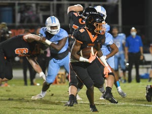 Cocoa's O.J. Ross runs in the 2020 Barbecue Bowl between Rockledge and Cocoa High at Dick Blake Stadium in Cocoa. The Tigers won, 45-34.