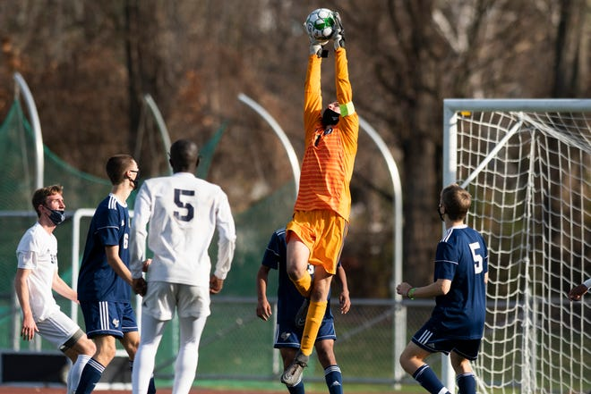 Essex goalie Andrew Seavers (1) leaps to make a save during the Division I boys soccer championship game between the Burlington Seahorses and the Essex Hornets at Buck Hard Field on Saturday afternoon November 07, 2020 in Burlington, Vermont.