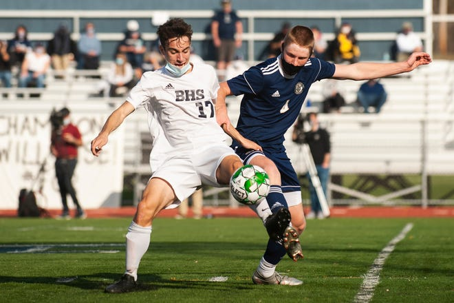 Essex's Elijah Bostwick (4) battles for the ball with Burlington's Cyrus Perkinson (17) during the Division I boys soccer championship game between the Burlington Seahorses and the Essex Hornets at Buck Hard Field on Saturday afternoon November 07, 2020 in Burlington, Vermont.