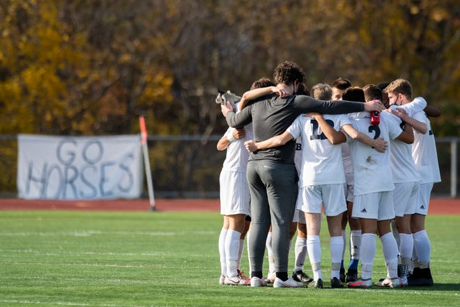 Burlington huddles together during the Division I boys soccer championship game between the Burlington Seahorses and the Essex Hornets at Buck Hard Field on Saturday afternoon November 07, 2020 in Burlington, Vermont.