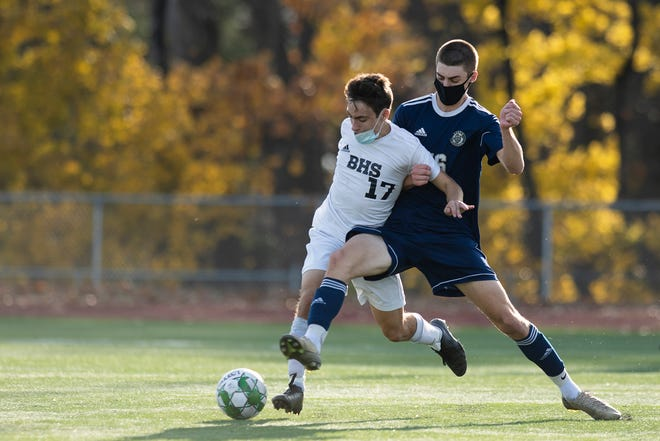 Essex's Stefan Digangi (16) battles for the ball with Burlington's Cyrus Perkinson (17) during the Division I boys soccer championship game between the Burlington Seahorses and the Essex Hornets at Buck Hard Field on Saturday afternoon November 07, 2020 in Burlington, Vermont.