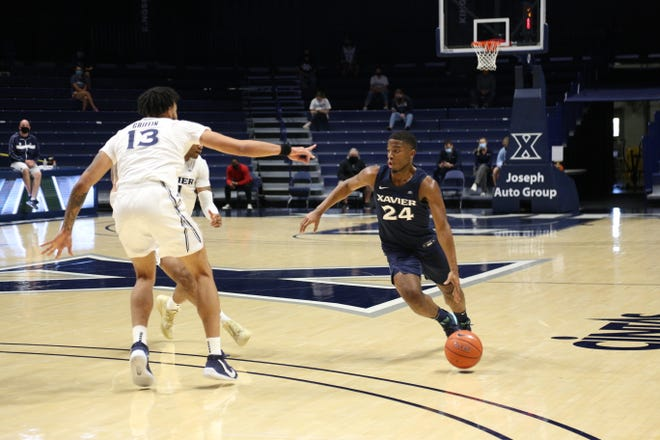 Xavier University sophomore guard KyKy Tandy (24) drives on Saturday, Nov. 7, 2020, during an inter-squad scrimmage at Cintas Center