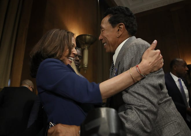 Singer and songwriter Smokey Robinson embraces Sen. Kamala Harris prior to a hearing of the Senate Judiciary Committee on May 15, 2018 in Washington, DC.