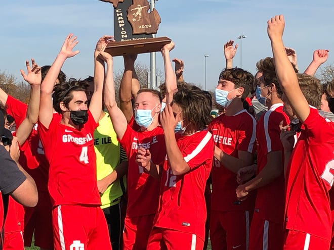 Grosse Ile celebrates after winning the Division 3 state boys soccer title over Grand Rapids South Christian, 1-0, on Saturday, Nov. 7, 2020, in Novi.