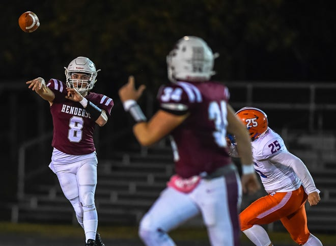 Henderson County quarterback Ben Dalton (8) fires a pass to teammate Turner Mattingly (34) as the Henderson County Colonels play the Marshall County Marshals at Henderson's Colonel Stadium Friday, November 6, 2020.
