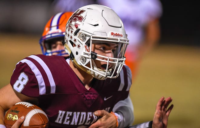 Henderson County's Ben Dalton (8) scrambles with the ball as the Henderson County Colonels play the Marshall County Marshals at Henderson's Colonel Stadium Friday, November 6, 2020.