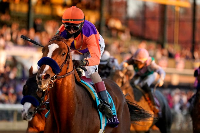 John Velazquez (9) rides Authentic to win the Breeders' Cup Classic horse race at Keeneland Race Course, in Lexington, Kentucky, on Saturday, Nov. 7, 2020.