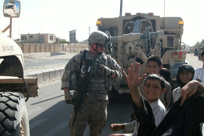 U.S. Army Sgt. Michael Keene pictured with local children while serving in the Middle East.