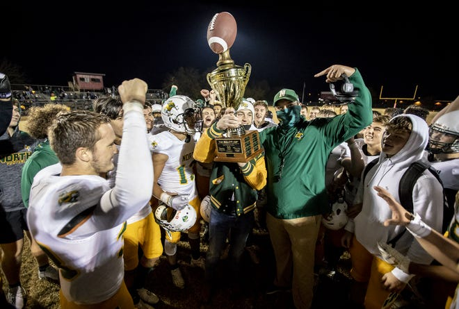 North Bullitt head coach Adam Billings, right, points to a Zach Vorbrink after Zach was handed the Bullitt Cup Trophy. The North Bullitt Eagles defeated the Bullitt East Chargers in overtime, 60-59. November 6, 2020