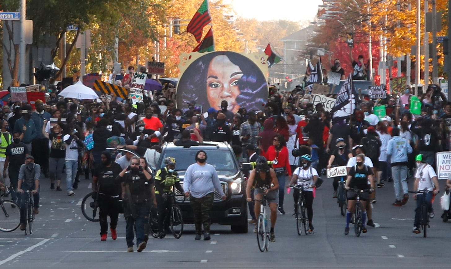 Protesters move the Breonna Taylor memorial from Jefferson Square Park to Roots 101 Saturday evening.  11/07/20