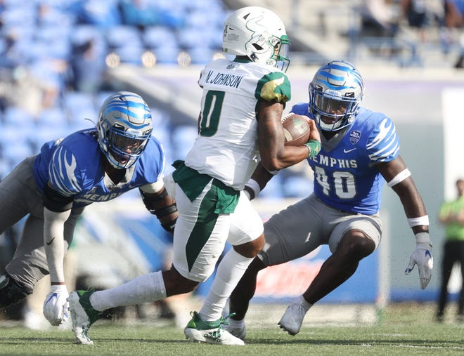 South Florida quarterback Noah Johnson impressed his coach Saturday against Memphis, mainly for his ball security and running.