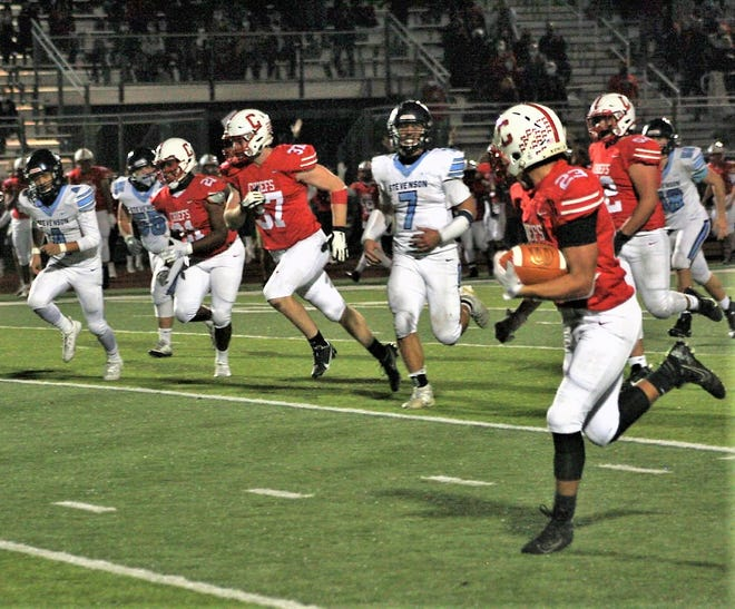 Wesley Faulkner has nothing but green turf in front of him after taking an interception to the house Friday night.