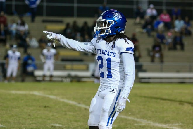 San'Tonio Coleman points out a player to watch during the FHSAA play-in game against Milton. Coleman has shined on both sides of the ball for Washington.