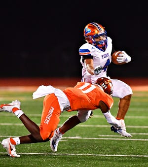 York High's Jahiem White carries the ball against Central York last season in the District 3 Class 6-A title game.