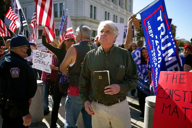 Supporters of President Donald Trump demonstrate outside the Pennsylvania State Capitol, Saturday, Nov. 7, 2020, in Harrisburg, Pa., after Democrat Joe Biden defeated President Donald Trump to become 46th president of the United States. (AP Photo/Julio Cortez)