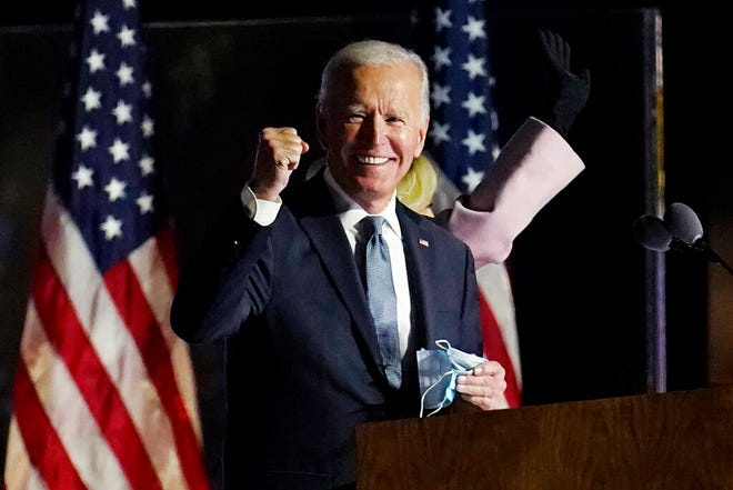 Democratic presidential candidate former Vice President Joe Biden speaks to supporters, early Wednesday, Nov. 4, 2020, in Wilmington, Del. Biden defeated President Donald Trump to become the 46th president of the United States on Saturday, positioning himself to lead a nation gripped by historic pandemic and a confluence of economic and social turmoil. (AP Photo/Paul Sancya)