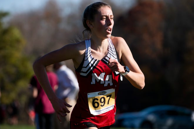 Moon Area's Mia Cochran sprints to a gold medal finish in the PIAA Class 3A girls' Cross Country Championships in Hershey on Saturday, November 7, 2020. Cochran won in 18:28.