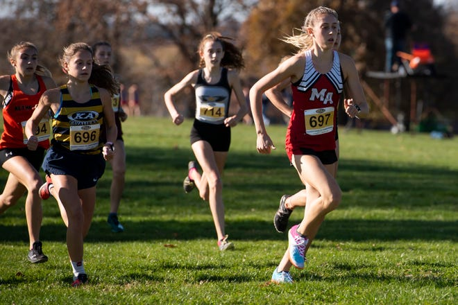 Moon Area's Mia Cochran (697) leads the pack in the PIAA Class 3A girls' Cross Country Championships in Hershey on Saturday, November 7, 2020.