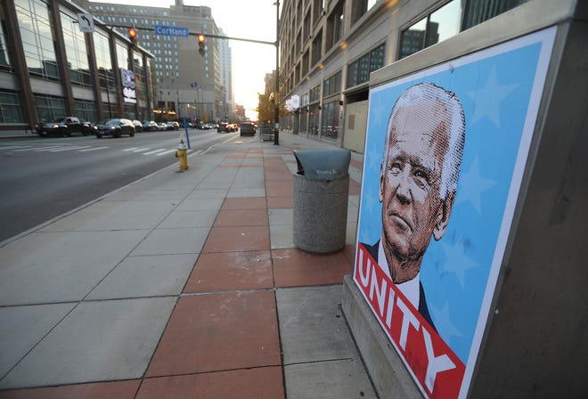 A poster of Joe Biden with the work Unity underneath it was posted on a box on Main Street.  Area residents came to the Liberty Pole to celebrate the results naming Joseph Biden as President-elect and Kamala Harris Vice President-elect,  Nov. 7, 2020.