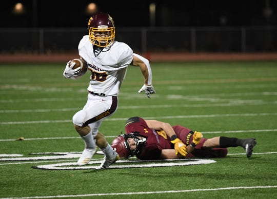 Harrisburg Tigers receiver Lincoln Carlson gets away from Sioux Falls Roosevelt defender Joey Hughes in the Class 11AAA playoff game on Friday night.