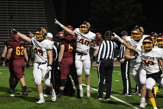 Harrisburg Tigers linebacker Cade Larson makes a fumble recovery to stop Sioux Falls Roosevelt near the goal line during the semifinal playoff game Friday night.