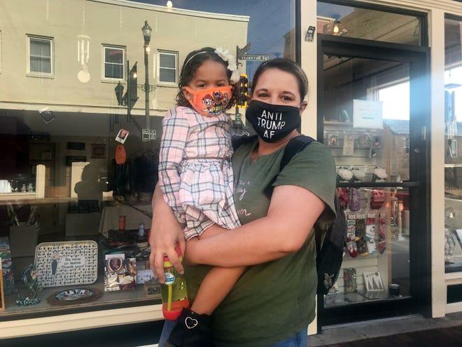 Nicole McCauley, of Stuarts Draft, with her daughter walking down Beverley Street in Staunton on Nov. 7, 2020.