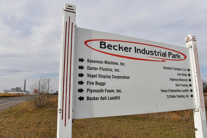 A sign points out businesses in the Becker Industrial Park Saturday, Nov. 7, 2020 in Becker. State legislators approved a bonding bill in October that included $20.5 million for Becker business development.