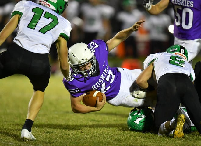Albany's Tate Hoffarth stretches for a gain during the game Friday, Nov. 6, 2020, at Albany High School.