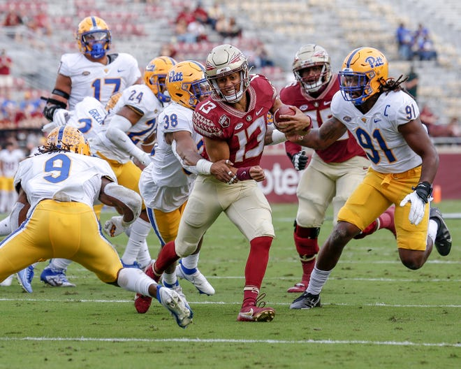 Quarterback Jordan Travis (13) of the Florida State Seminoles on a running play during the game against the Pittsburgh Panthers at Doak Campbell Stadium on Bobby Bowden Field on November 7, 2020 in Tallahassee, Florida.