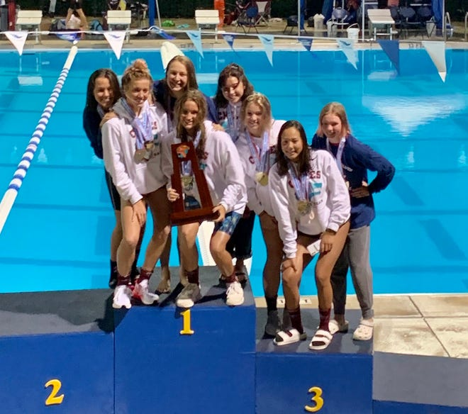 From left to right: Carly White, Stella Grace Watts, Shelby Pautsch, Emily Chorpening, Rachel Schmidtchen, Lydia Hanlon, Bella Ekk and Emelia Simone of Chiles High School celebrate with the 3A girls swimming championship trophy at Sailfish Splash and Aquatics Center in Stuart on Friday, Nov. 6, 2020.