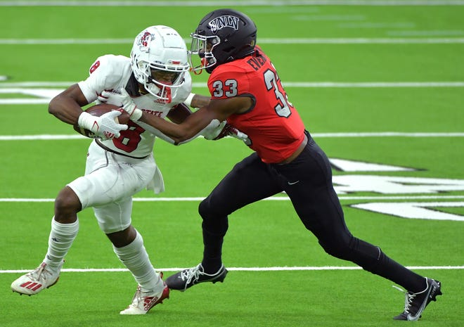 Fresno State receiver Chris Coleman (8) fights off a tackle attempt from UNLV's Sir Oliver Everett earlier this season.