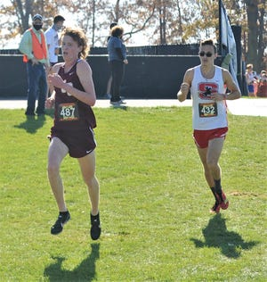 John Glenn's Chris Tooms and Sheridan's William Wilke compete in the Division II state cross country meet on Saturday at Fortress Obetz. Wilke earned All-Ohio honors in 21st and Tooms finished 47th.