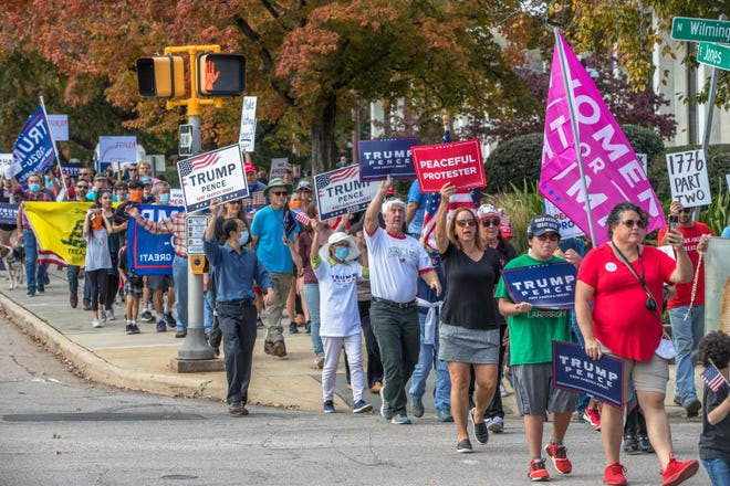 Supporters of President Donald Trump march to the State Capitol in Raleigh, North Carolina, to protest against election results and perceived corruption in the voting process on Nov. 7, 2020. Democrat Joe Biden has won the White House, according to unofficial results.